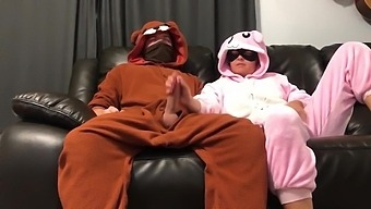 Bunny Pajama Girl Gives Handjob On Couch Watching Tv