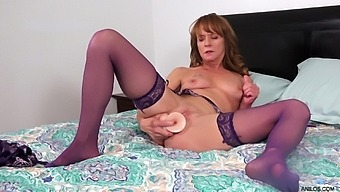 Mature Maven Cyndi Sinclair Wears Purple Lingerie During Sizzling Solo