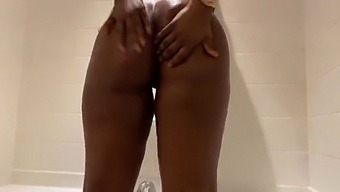 Amateur Ebony Rides Her Dildo In The Shower