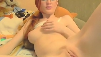 Redhead Dressing Eye-Glasses Presenting Her Flawlessly Boldly Colored Vagin