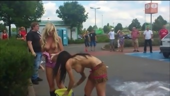 Soppy And Topless Females Illustrate Their Personal Tits Off In The Community