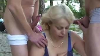 Incredibly Old Granny Normally Takes A Pair Of Cocks From Two Sides Outdoors