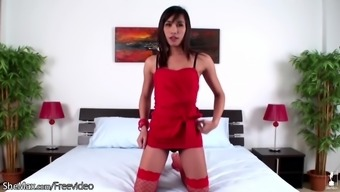 Attractive Femboy Within The Scarlet Outfit Gets Energetic Back With Her Warm Entire Body