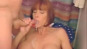 Red-Haired Milf With Large Plastic Titties Blows And Effect A Large Dong