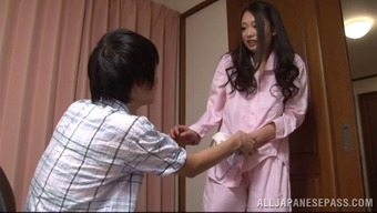 A Sweet Japanese Housewife Gives Her Mankind A Handjob
