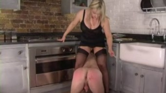 Femdom Corselette And Stockings Domme Spanks With The Cooking