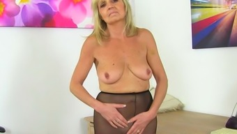 English Gilf Dolly Adds A Dildo To Operate On The Hunger Cunt