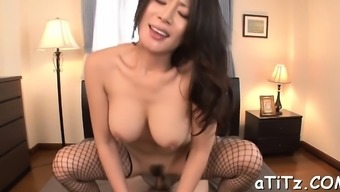 Pretty Far Eastern Playgirl Gives Interesting And Wild Titty Fuck