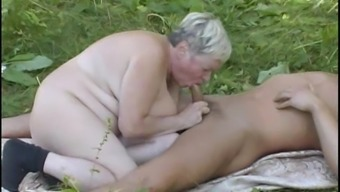 Sultry Granny Offers A Sloppy Blowjob In That Case Gets Nailed Open Air