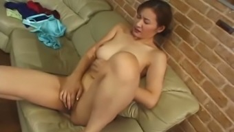 Reiko Kamiya Loves Masturbating Upon The Couch And She Even Serves As A Handjob Specialist