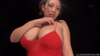 Japanese Chick Oda Mako Squeezes Her Tits While She Plays With A Dildo