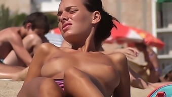 Pretty Busty Brunette Topless On The Beach