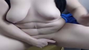 Fat Slut Shoves A Fist In Her Pussy